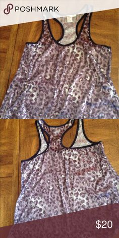 Kanvas racerback metallic top Gently used purple and silver tunic type top. In brand new conditions. Perfect for spring and summer nights. Pair this top with pink, white, black or blue jeans. Tops Tunics