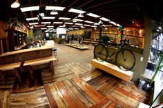 velo cult bike shop - Portland  Love the floors and open space  This shop has a bar & photobooth too!  (Click to see website)