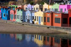 These are the colorful beach bungalows dotting the hillside at Capitola Beach in California