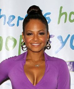 Christina Milians slicked-back, high bun hairstyle
