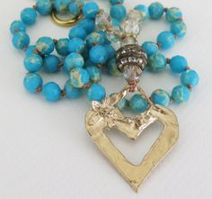 Knotted faceted blue impression jasper beads hold a golden bronze handcrafted artisan heart, Czech beads, rhinestone bead, gold plated toggle