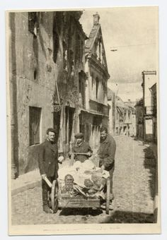 Abraham Sutzkever, an unidentified man, and Gershon Abramowicz bringing YIVO materials hidden during the war to a new Jewish museum. Vilna, 1944.