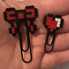 This bow and heart duo has everything a gal wants in life and love.  Check out Happy Hearts Paper Co. on Etsy and Instagram for more fun planner ideas and accessories! We have tons of unique and handmade perler bead creations.  #bookmarks #planners #happyplanner #plannerclips #planneraccessories #plannergoodies #plannersupplies #officedecor #deskdecor #bows #perlerbeads