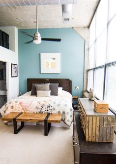 I love the bench at the foot of the bed. Eric & Kellie's Pencil Factory Loft