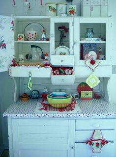 beautiful hutch!!  Love the oilcloth cover