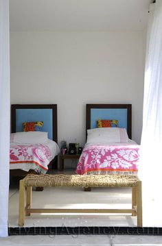 shared kids room. MONI, we could totally make headboards like that. Pink for B & Green for P. daddy can help us frame them. It's an idea