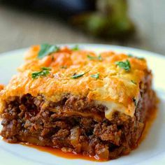 Moussaka is the iconic hearty Greek dish composed of layers of eggplants, saucy ground meat and topped with Béchamel sauce. Moussaka is the iconic hearty Greek dish composed of layers of eggplants, saucy ground meat and topped with Béchamel sauce. Greek Recipes, Meat Recipes, Healthy Dinner Recipes, Cooking Recipes, Healthy Appetizers, Plats Weight Watchers, Weight Watchers Meals, Middle Eastern Dishes, Greek Dishes