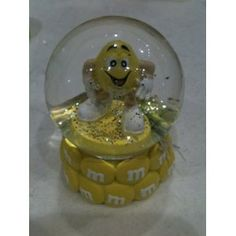 M's Yellow Character Snow Globe