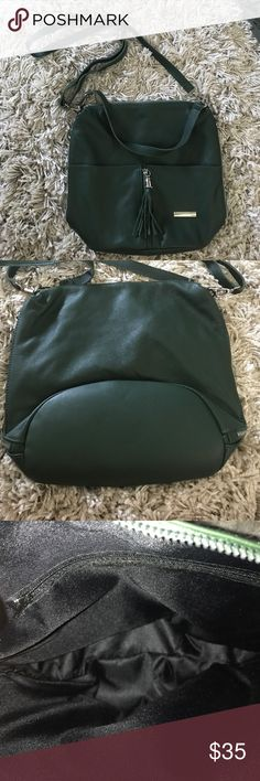Leather green bag Super cute and made of real leather, I never once used it and i bought it while traveling in Europe on an impulse buy ! I love it but it just isn't my style. All zippers intact and perfect as an every day purse Bags Shoulder Bags