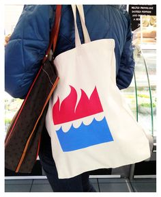 A classic HarperCollins Publishers Fire-and-Water Colophon tote bag, spotted at a deli on West 52nd Street!