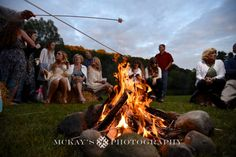 S'mores fire at a wedding in the Finger Lakes by Rochester photographer Heather McKay  mckaysphotography.com