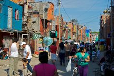Shanty town, right next to the train tracks, not far from Retiro and Recoleta, On the busy streets of Villa 31 by Beatrice Murch