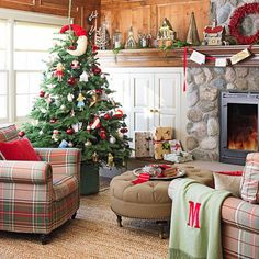 Love this whole thing.  Stone fireplace.  Plaid furniture. Christmas tree. Built ins. Seagrass rug. Round ottoman.