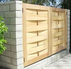 Guttman Gate--Client had 4 trash cans to hide and wanted something that is more aesthetically pleasing close to the entry driveway. Re-sawn book matched eastern white cedar planks are bent front and back of the oval shaped dowel that is placed vertically.