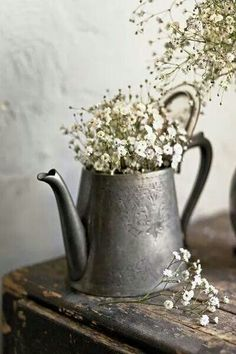 Old silver teapot becomes a pretty vessel for baby's breath flowers ~