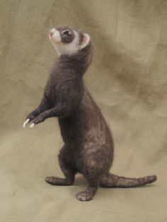 Needle felted ferret by Hanna Stiles.