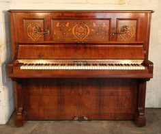 An antique, Bechstein Model III upright piano with a rosewood case and floral inlaid panels  at Besbrode Pianos.