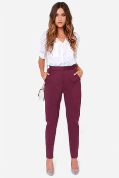 """With a dash of mystery thrown into the mix, the Fantastic Phantom Burgundy High Waisted Pants are the best pants you could buy all season! With a touch of plum purple, these cotton blend pants have a silky smooth texture with the perfect touch of stretch. Darting below the banded waist create a comfortable fit as the legs taper down to a glamorous finish. Two front pockets. Hidden side zipper/clasp closure. Unlined. Model is 5'8"""" and wearing a size small. 70% Cotton, 30% Rayon. Hand Wash…"""