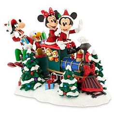 Santa Mickey's coming down the track with a smoky stack and gifts all packed! The rest of the Disney gang provide elf-help on this sparkling collectible sculpture that will become a treasured centerpiece for your annual holiday display.