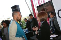 Grey's Anatomy star Jesse Williams chats with a member of the Crizal team