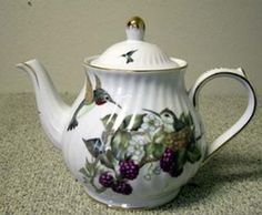This gorgeous teapot features a very captivating pattern of delicate hummingbirds along with a beautiful gold trim along the edges. The handle is also trimmed in gold. It is generously sized at 6 Cups.  Other accessories in this pattern are available below.  This pattern is available in other shapes.  Call our customer service representative at 866-380-0815 for more information