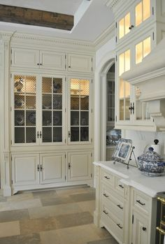 Love all the beautiful cabinets and the wonderful storage in his home _~ The Enchanted Home
