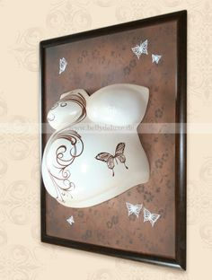 Painted belly cast in wooden frame