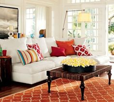 white sofa home decor. I would do with green or acqua instead of the coral/red color scheme. A Simple And Forever Stylish Combination: White Sofa And Colorful Pillows - Home Decorating Trends Fall Living Room, Simple Living Room, Living Room White, Living Room Decor, Dining Room, Dining Table, Cozy Living, Small Living, Kitchen Dining