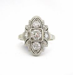 <p>Spectacular Art Deco Diamond Ring with Lots of Intricacy, 3 Diamonds Down the Middle and 2 Side Diamonds, set in 18k White Gold</p>