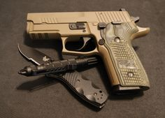 My SIG Sauer P229 9mm Scorpion, Uzi tactical pen and Benchmade Mini Barrage.  Awesome EDC setup.