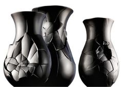 Broken, rough and irregular outer faces. Black vases by Dror Benshetrit.