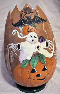 Hand painted, carved at the top Halloween gourd. Just decided not all gourds have to be serious. With ghost, jack o lanterns, bat and spider, halloween gourds Halloween Gourds, Halloween Bottles, Halloween Rocks, Holidays Halloween, Halloween Crafts, Halloween Decorations, Decorative Gourds, Hand Painted Gourds, Painted Pumpkins