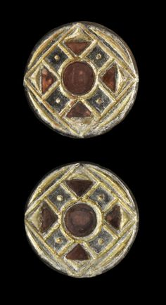 "Merovingian Frankish Silver-Gilt Disc Brooch Pair, 6th century A.D. ~Other version of the ""sun cross"", in the form of an eight-spoked wheel (nothing to do with many wheel symbols used at the time in heraldry). This can be understood as a marking of cross-quarter days (midpoints between seasons) along with the four spokes of the equinoxes and solstices."
