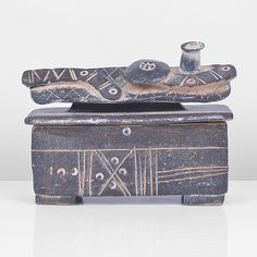 Lidded Box, Stoneware, dry dark brown glaze, the lid mounted with a reclining figure with shield, incised linear markings inlaid with pale pink sli. Ceramic Sculptures, 3d Design, Ceramic Art, Stoneware, Tea Pots, Candle, Decorative Boxes, Clay, Pottery