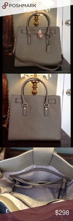 """🌹FINALPRICE🌹NWT Michael Kors Hamilton Lg Tote NWT. The Michael Kors Emma Tote. Retail value $398.00. 100% Genuine Saffiano leather. Color is Dark Dune. Magnetic snap closure.  Signature 18k hardware. Has a key hung by leather strap that opens the decorative lock in front.  Rolled handles with optional chain leather Cross Body strap.  Tons of room. Bottom Width 14.5"""" Depth: 6"""" Height: 12 Strap Drop: 12 in Handle Drop: 8 in Michael Kors tag attached. MK paper carrying bag included.  NO…"""