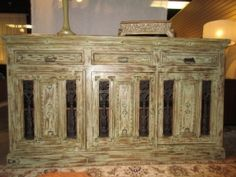 """$985.00  Item #: 40859 Made of reclaimed wood, this buffet comes in a distressed green finish. There are three small drawers on top and three doors below with cast iron accents. Could even be used as a TV console in a living room space. Measurements are 72"""" long x 18"""" deeo x 40"""" high."""