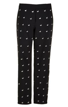 These cropped wool pants in the style of tailored meanswear suiting have a modern silhouette and feature an embroidered bull print in the Spanish theme. Pair with a blazer and ankle boots or pumps. Flat front closure. Front slash, back welt pockets. Unlined.    53% Polyester, 43% Virgin Wool, 4% Elastane. Professional Dry Clean Only.  Style Number: TP216TRW34467  Available in: Black