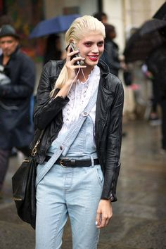 Beyond cool in conductor overalls and a Lace front blouse topped off with a leather jacket. Paris  #DevonWindsor #Offduty