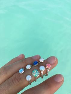 Lifou 'Glimmering Sea' & 'Glimmering Sunrise' silver rings with fire opals 🌊 Available with light blue, menta, deep blue & coral opals 💎💕 Deep Blue, Light Blue, Fire Opals, Coral Blue, Sunrise, Silver Rings, Mint, Sunrises, Sunrise Photography