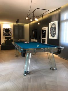 Turning the lights on to enlighten pieces of art and design. Wow!  #luxury #interiors #inspiration #billiard #game #furniture #modernArt