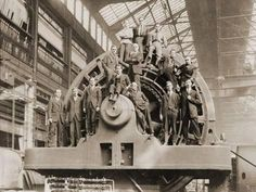 Photo: Businessmen Pose on a Giant Westinghouse Electrical Generator, 1918 : Mechanical Art, Figurative Art, Professional Photographer, Find Art, Framed Artwork, Electric Generators, Pop Culture, Poses, Pure Products