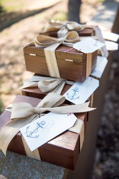 Groomsmen gifts were housed in wooden boxes wrapped with ribbon. Photography: EDLT Photo. Read More: http://www.insideweddings.com/weddings/an-oceanfront-vintage-inspired-wedding-in-laguna-beach-california/699/