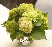 Lovely #green flower arrangement in silver bowl.
