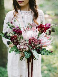 Picture of a lush and bold wedding bouquet with king proteas, burgundy and plum blooms and bold leaves for a fall boho bride Tropical Wedding Bouquets, Simple Wedding Bouquets, Protea Wedding, Bride Bouquets, Floral Wedding, Boho Wedding, Wedding Dress, Protea Bouquet, Burgundy Flowers