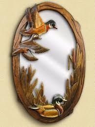 This beautiful hand-crafted mirror features a wood-carved scene of three flying ducks exploring the brush. This mirror is a wonderful functional addition to the wildlife décor in your woodland home, c Wood Carving Designs, Wood Carving Patterns, Rustic Mirrors, Wood Mirror, Intarsia Woodworking, Woodworking Patterns, Woodworking Projects, Wooden Art, Wooden Crafts