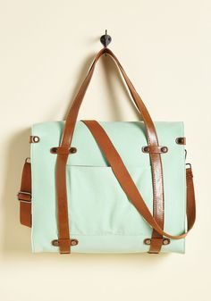 Camp Director Tote in Mint | Mod Retro Vintage Bags | ModCloth.com  When the cabins shutter up for the season, take a bit of camp charm with you by packing your essentials in this rustically refined tote! Adorned with brown faux-leather handles, an adjustable strap, and studded accents, this mint, structured bag makes sure you command a smile wherever you wander.