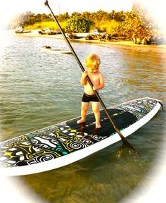 My grandson takes to paddle boarding  #sup #paddleboard #standuppaddle