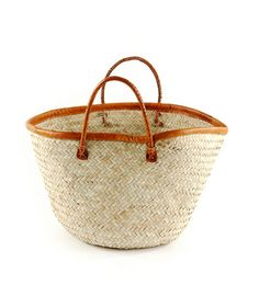 This fair trade durable basket is hand woven from Palm. This durable basket is built to stand the test of time and retain is usefulness and beauty for years. This basket is perfect for the beach, the