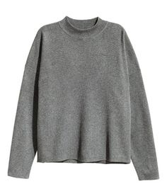 Fine-knit jumper in a cotton blend with a ribbed turtle neck and dropped shoulders.