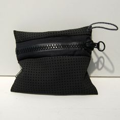 Clutch or pencil bag? We cant figure out if this recycled wetsuit from Alexandra Cassaniti is more than a pouch.